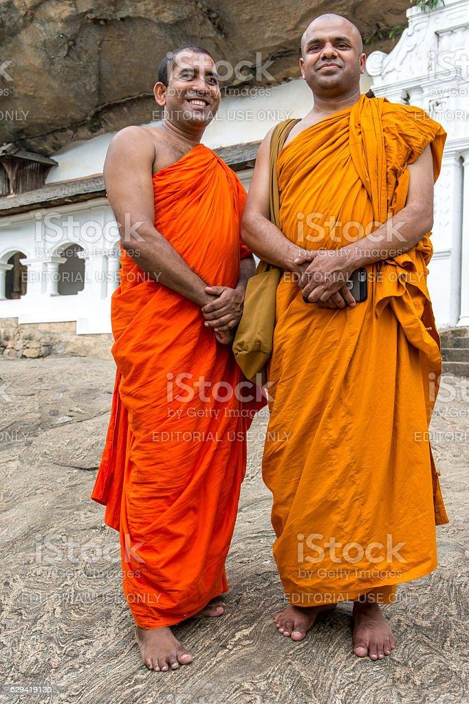 Buddhist monks in Dambulla, Sri Lanka stock photo