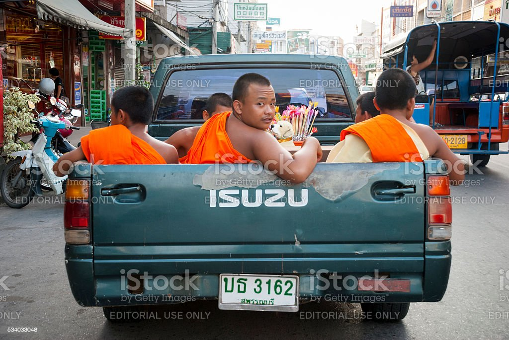 Buddhist monks in Kanchanaburi, Thailand stock photo