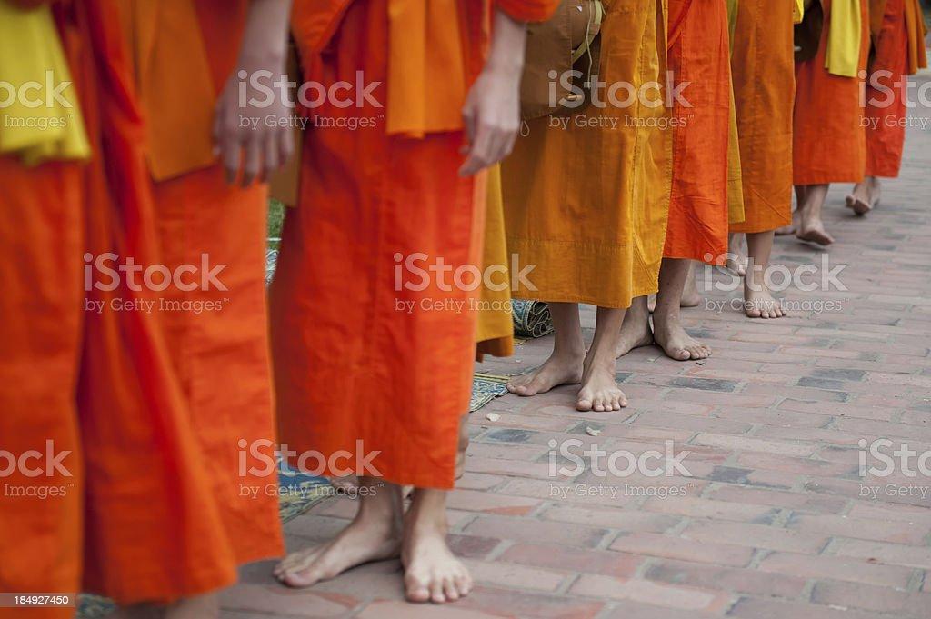 Buddhist monks in queue stock photo