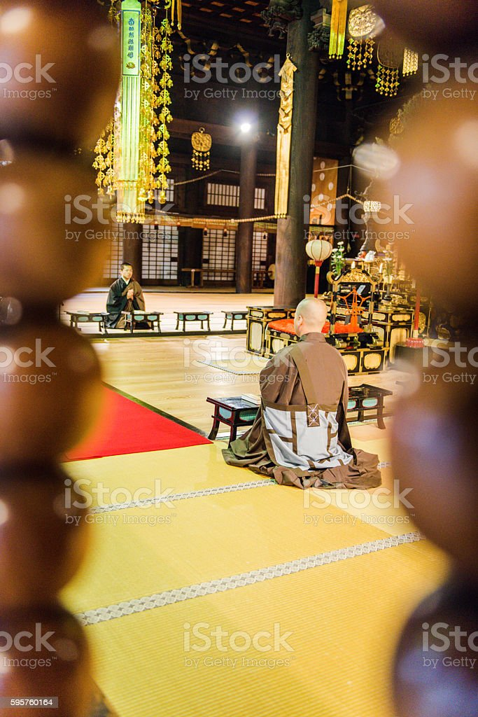 Buddhist Monks Praying at Chion-ji Temple in Kyoto, Japan stock photo