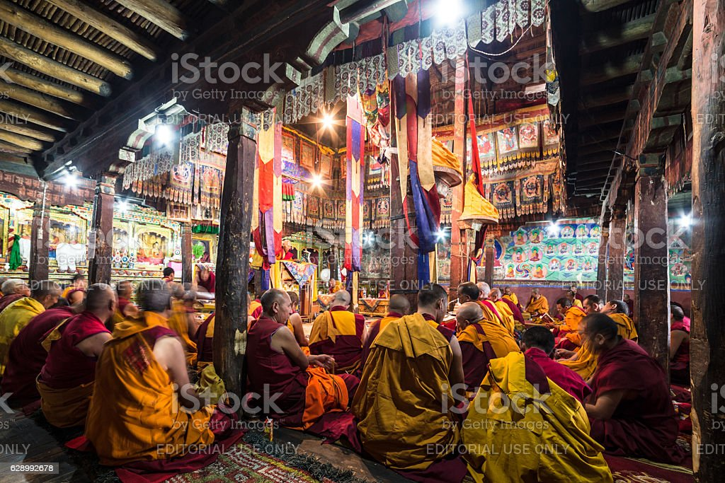 Buddhist monks praying in Thiksay monastery stock photo