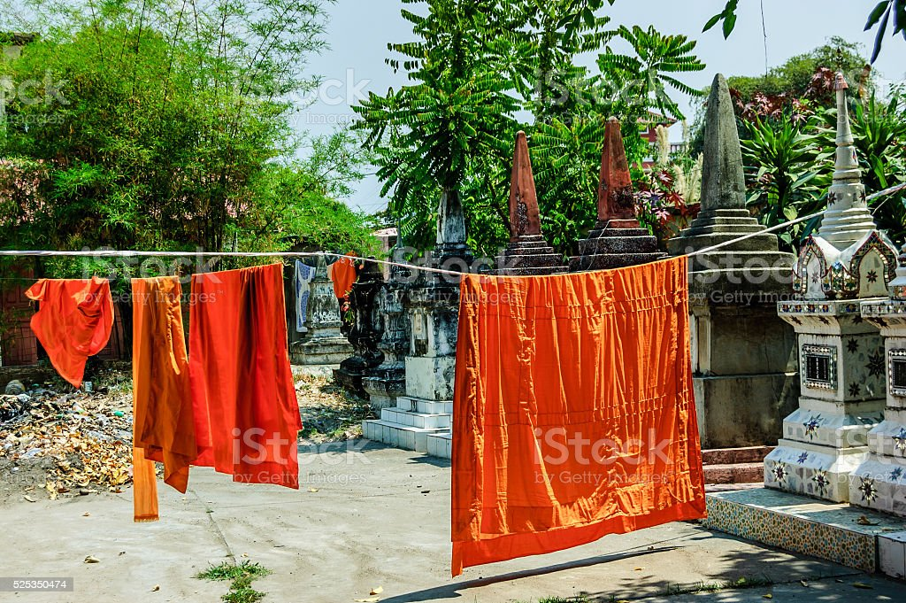 Buddhist monks' robes hanging to dry stock photo