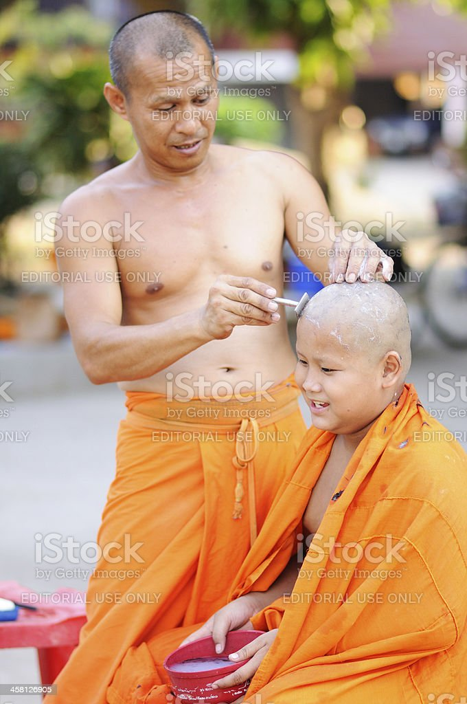 Buddhist monks shave head royalty-free stock photo