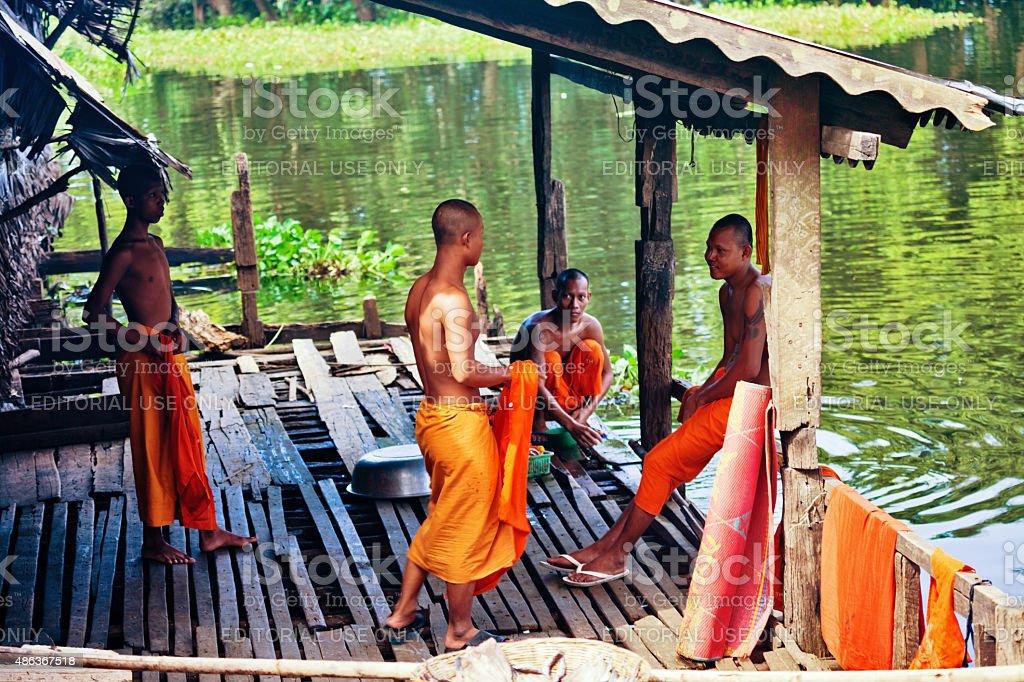 Buddhist monks talking near the Tonle Sap lake stock photo