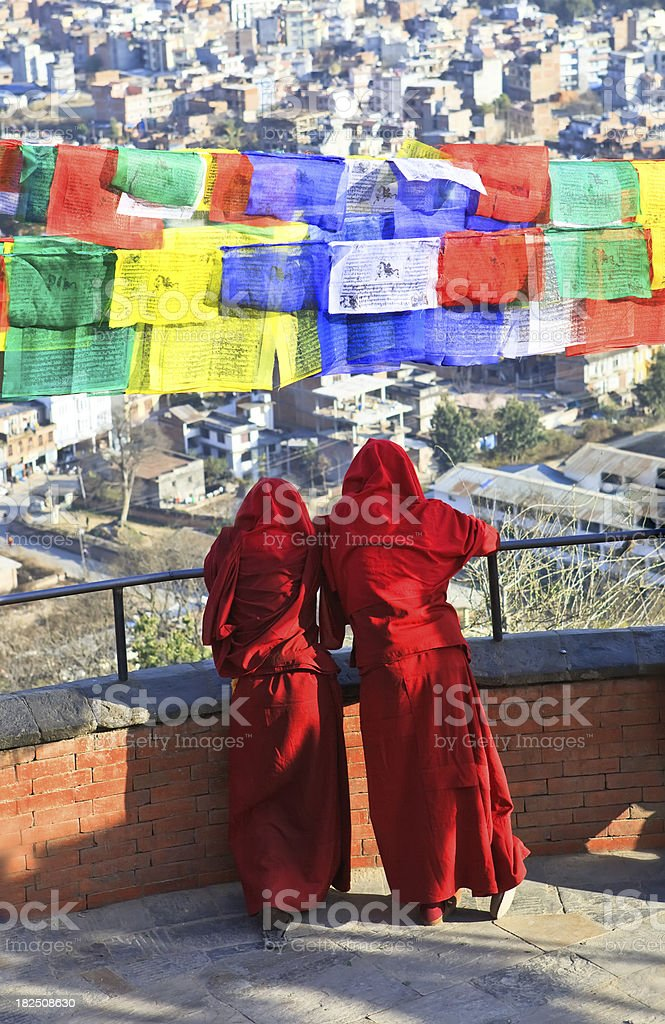 buddhist monks under tibetian flags royalty-free stock photo