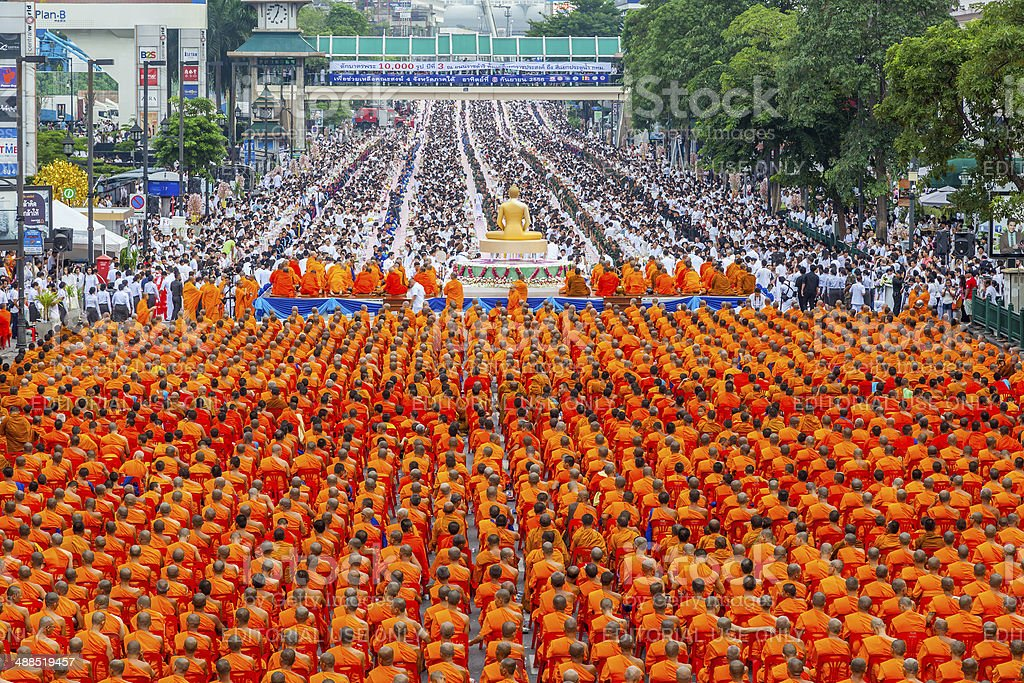 10,000 Buddhist monks waiting for people give food offerings royalty-free stock photo