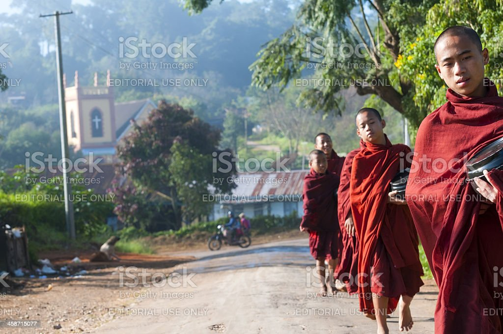 Burmese monks and Christian church royalty-free stock photo