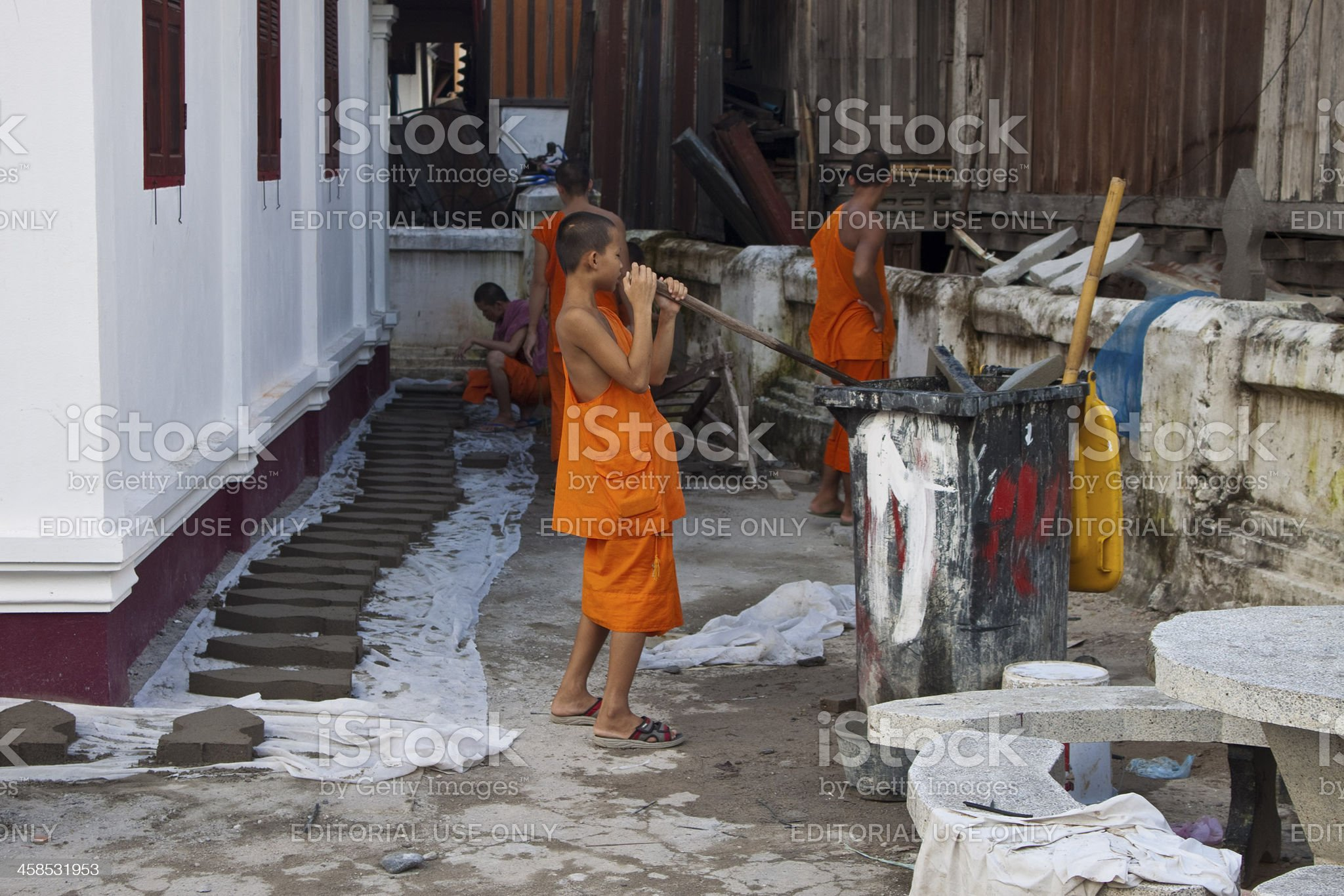 Buddhist monks work with concret royalty-free stock photo