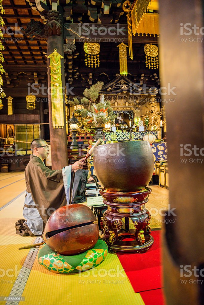 Buddhist Moonk Praying at Chion-ji Temple in Kyoto, Japan stock photo