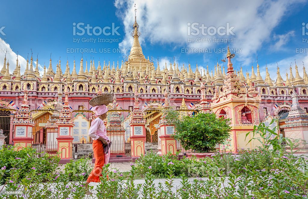 Buddhist nun carrying a thing on her head stock photo