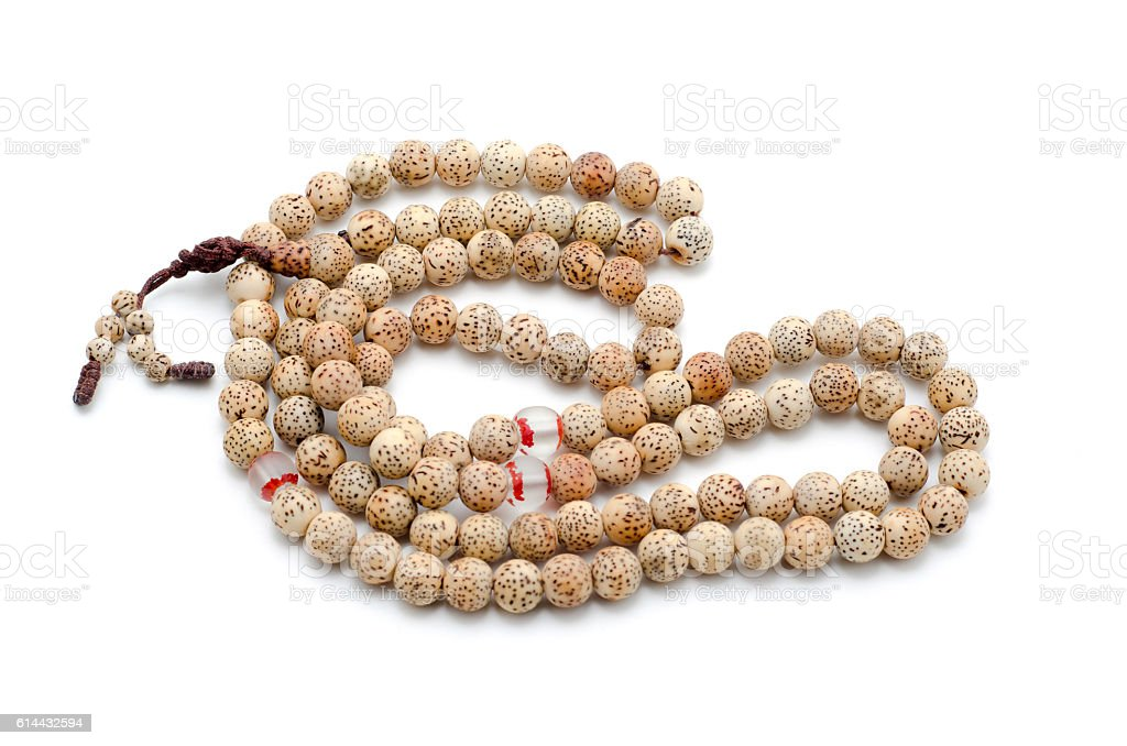 Buddhist or Hindu prayer beads isolated on white. stock photo