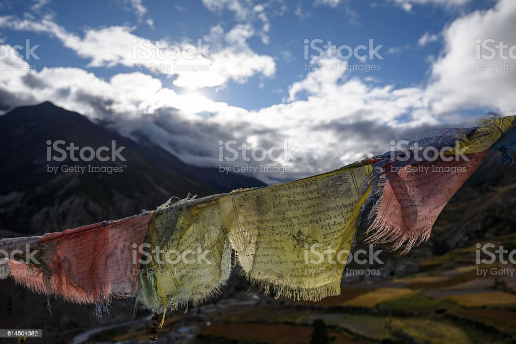 buddhist prayer flag in a himalayan valley stock photo