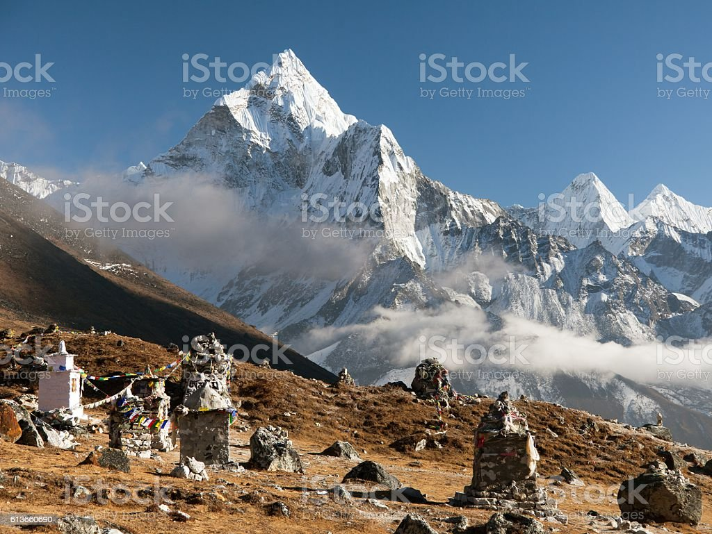 buddhist prayer flags and chortens under mount Ama Dablam stock photo
