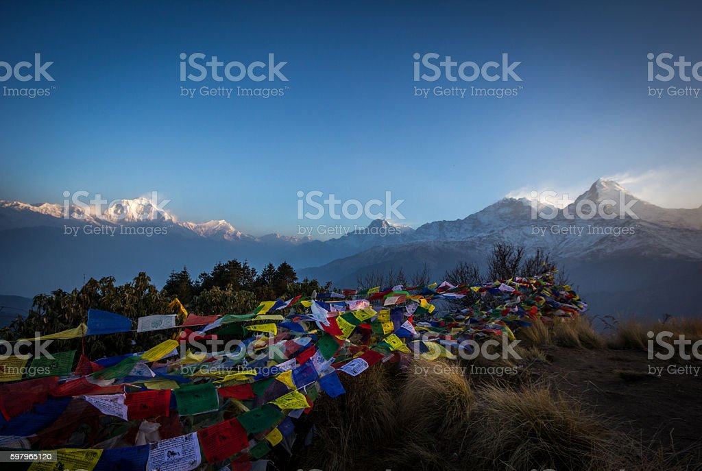 Buddhist prayer flags flapping in the wind - Poon Hill stock photo