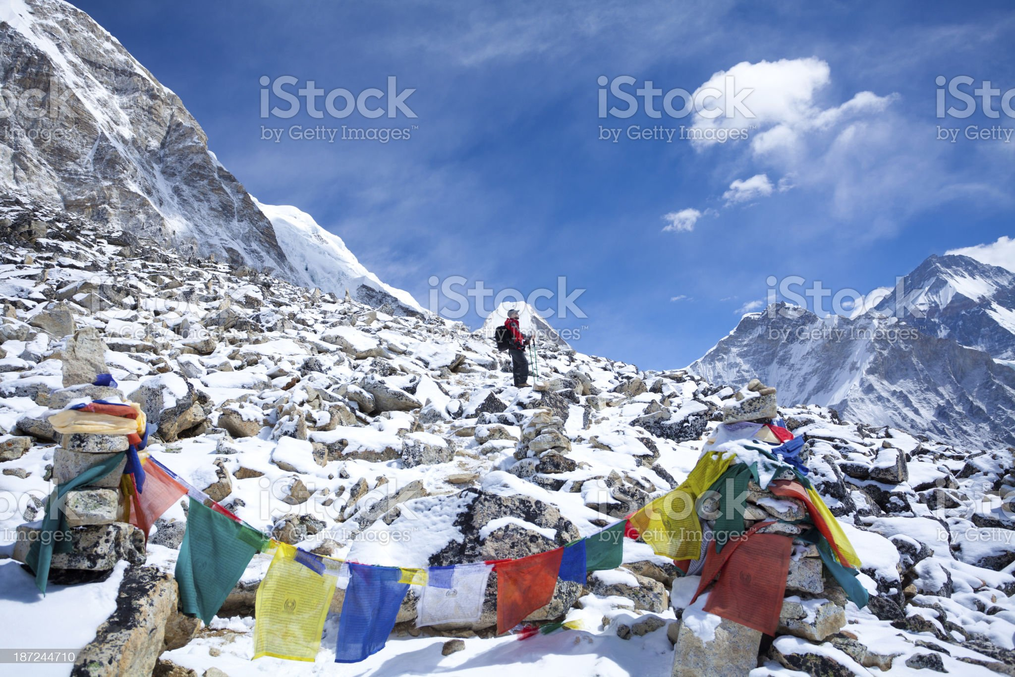 Buddhist Prayer flags in the Himalayas and hiker royalty-free stock photo