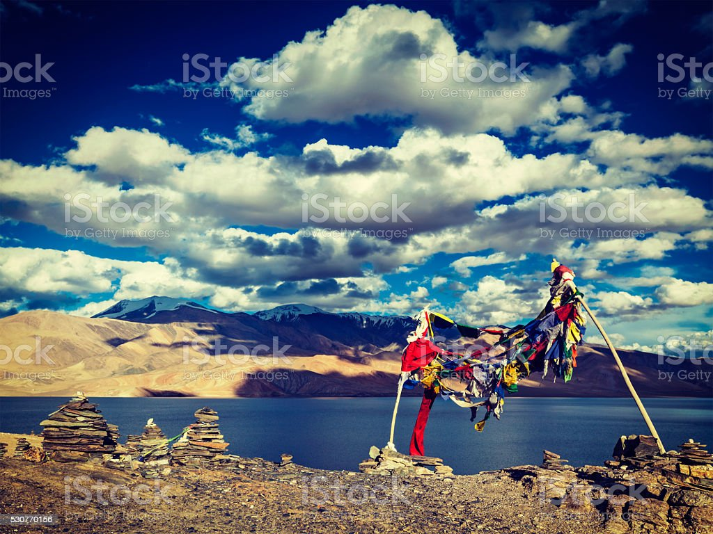 Buddhist prayer flags lungta at Himalayan lake Tso Moriri stock photo