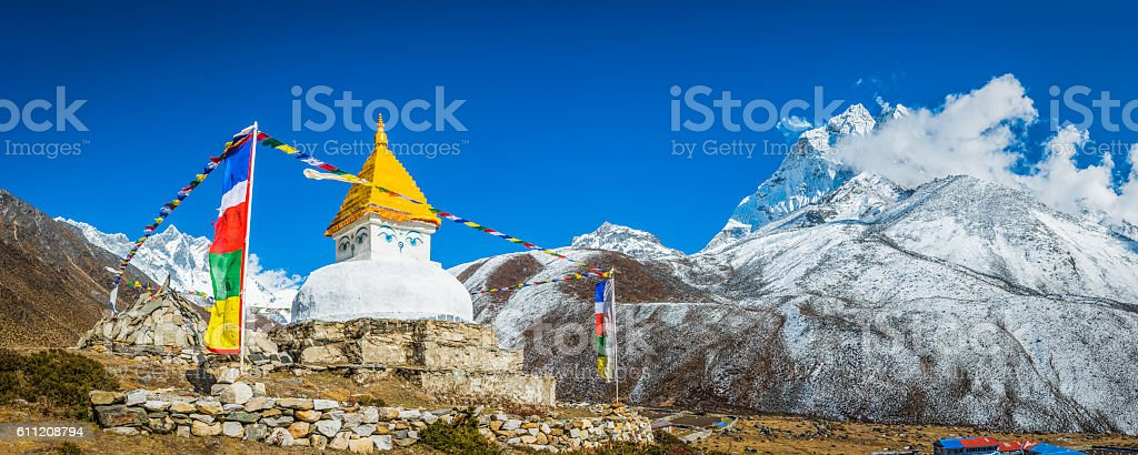 Buddhist prayer flags stupa shrine high in Himalayan mountains Nepal stock photo