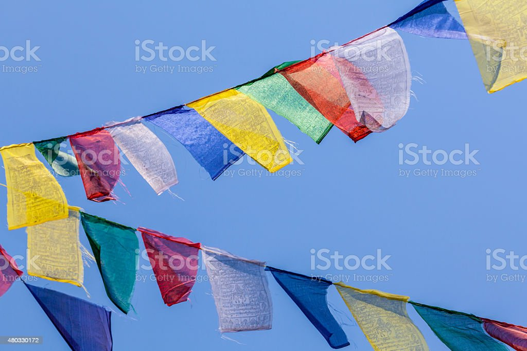 Buddhist prayer flags the holy traditional flag in Bhutan stock photo