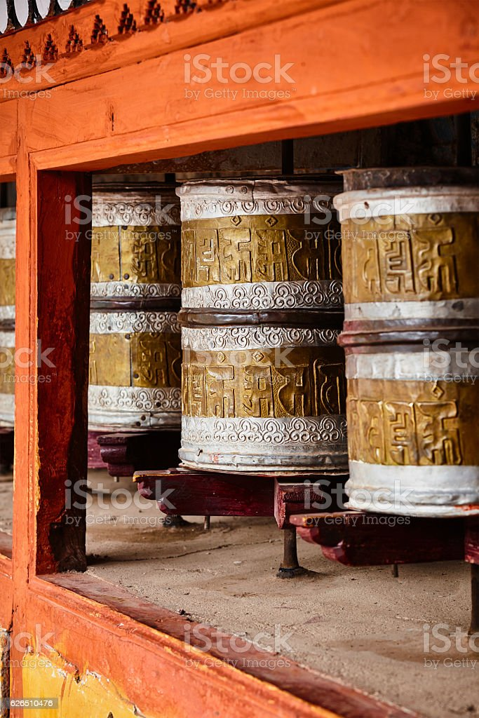 Buddhist prayer wheels in Hemis monstery. Ladakh, India stock photo