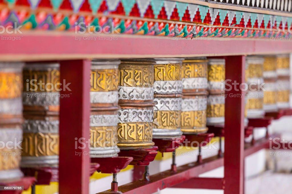 Buddhist prayer wheels in Leh, India. stock photo