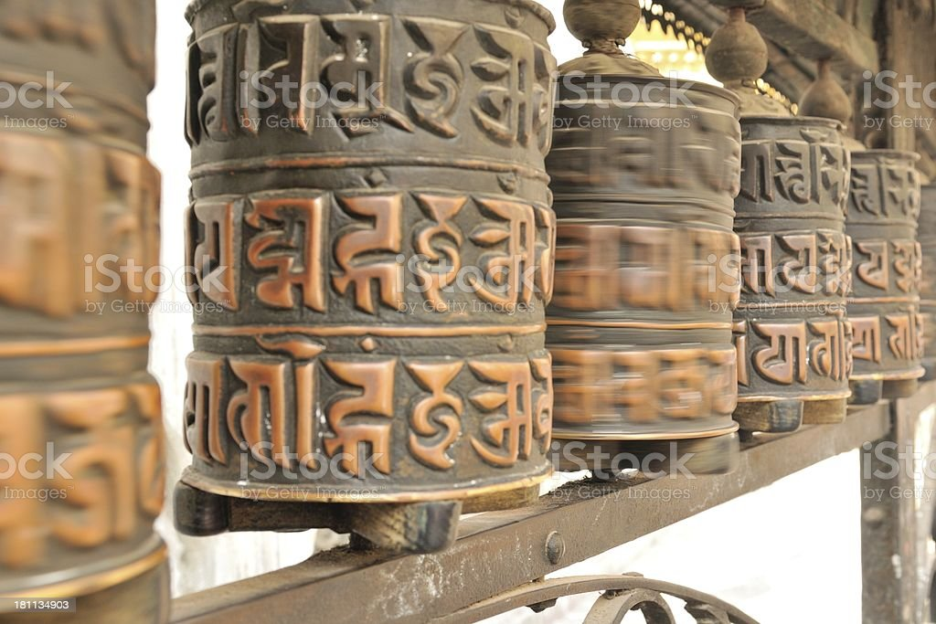 Buddhist Prayer wheels spinning at the Swayambhunath stupa royalty-free stock photo