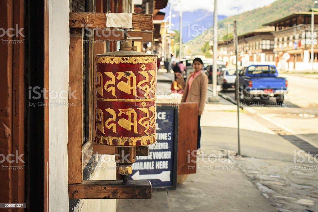 Buddhist praying wheel on foothpath stock photo
