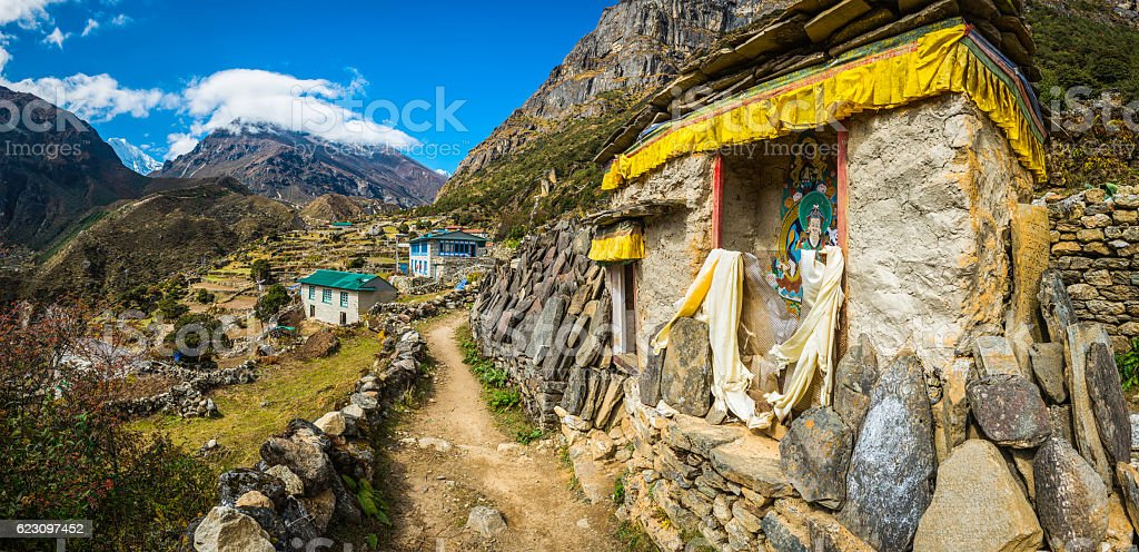 Buddhist shrine mani stones mountain trail Sherpa village Himalayas Nepal stock photo