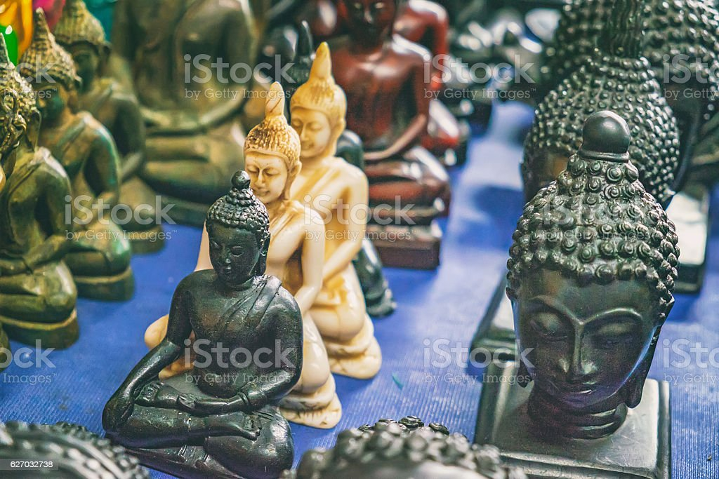 Buddhist statuettes and souvenirs at night market stock photo