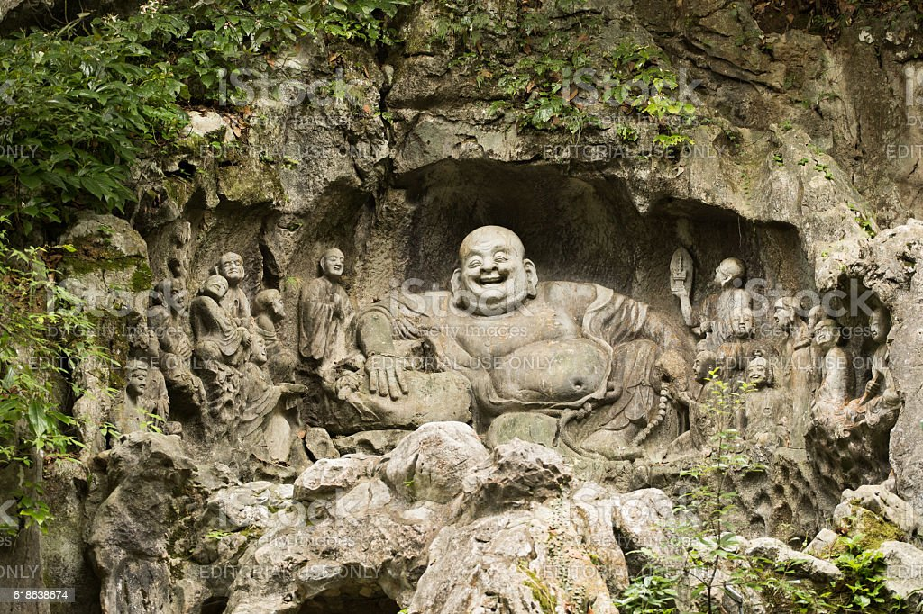 buddhist stone carvings in front of the Lingyin temple stock photo
