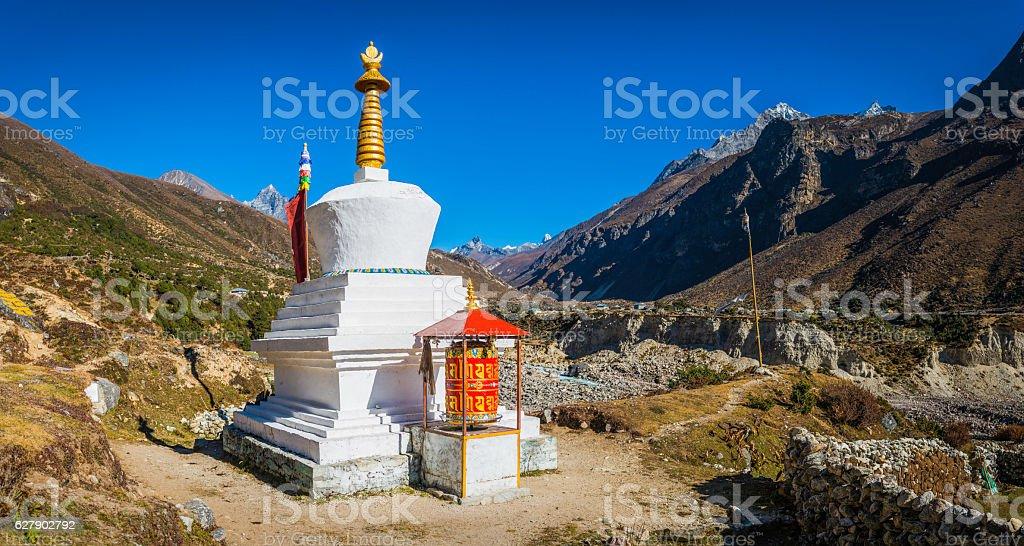 Buddhist stupa and prayer wheel on Himalayan mountain trail Nepal stock photo