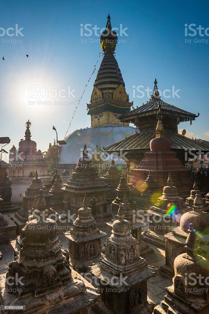 Buddhist stupa prayer flags and shrines Swayambhunath sunrise Kathmandu Nepal stock photo