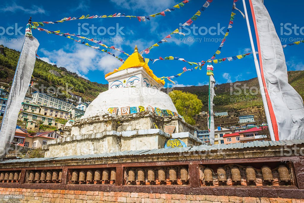 Buddhist stupa prayer flags Namche Bazaar Sherpa teahouses Himalayas Nepal stock photo