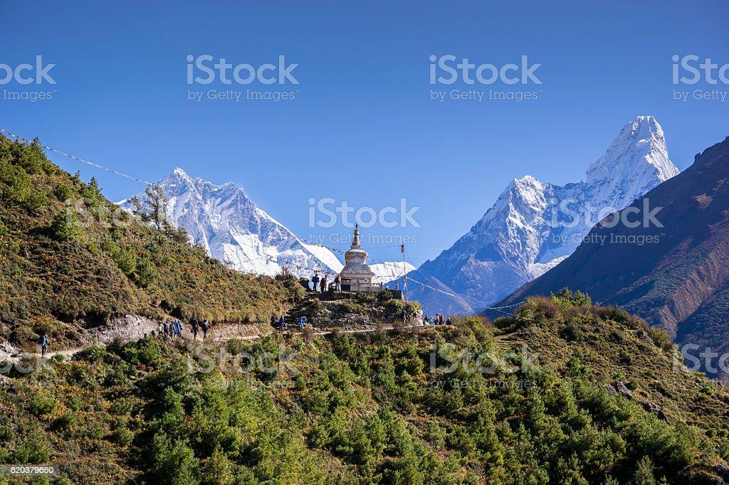 Buddhist stupa with mountain Lhotse and Ama Dablam stock photo