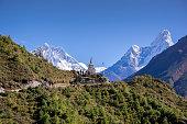 Buddhist stupa with mountain Lhotse and Ama Dablam