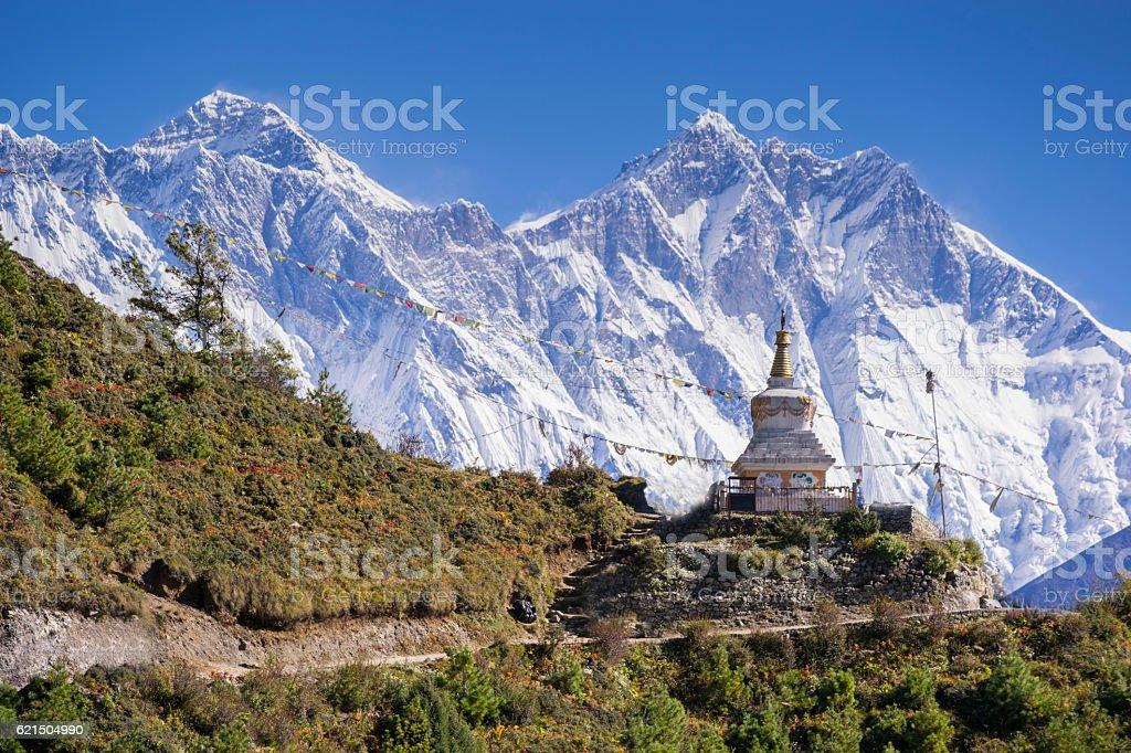 Buddhist stupa with mountain Lhotse behind. stock photo