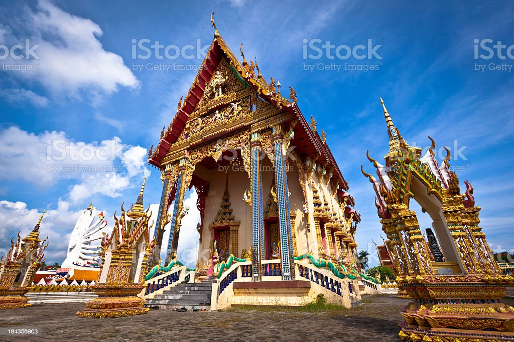 Buddhist temple against blue sky stock photo