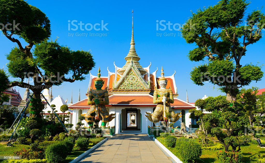 Buddhist Temple and ornate topiary trees in Bangkok, Thailand stock photo