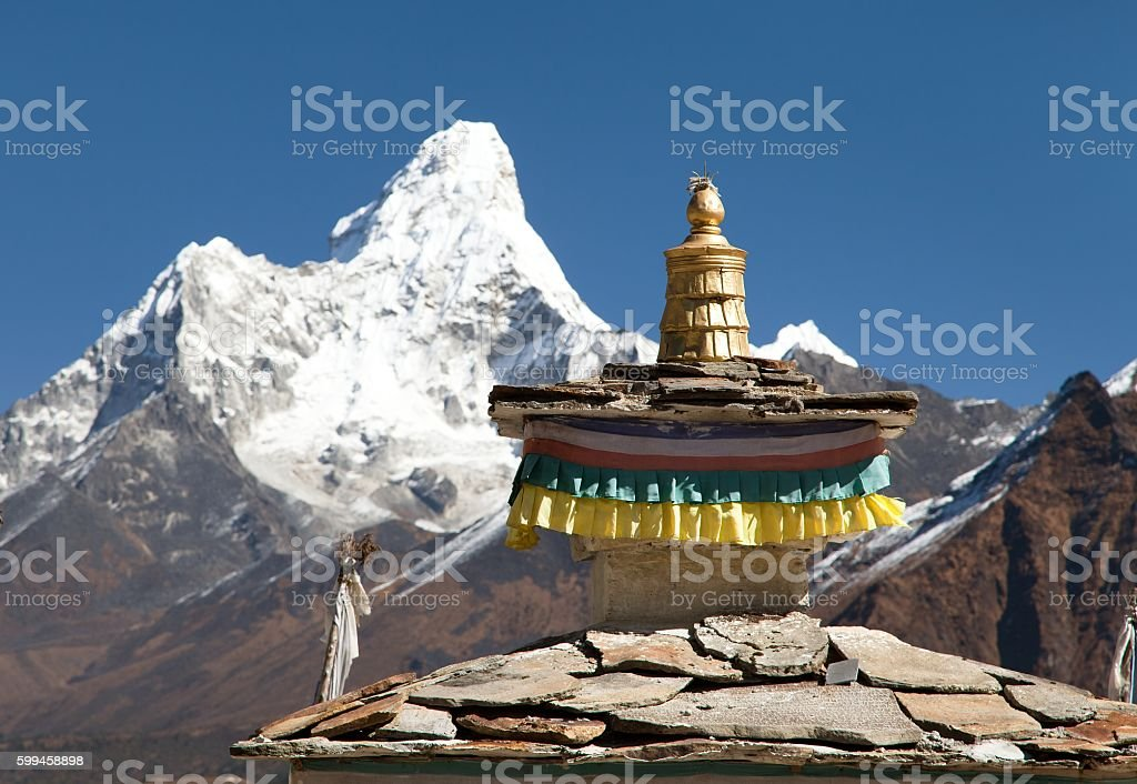 Buddhist Temple - detail of roof with mount Ama Dablam stock photo