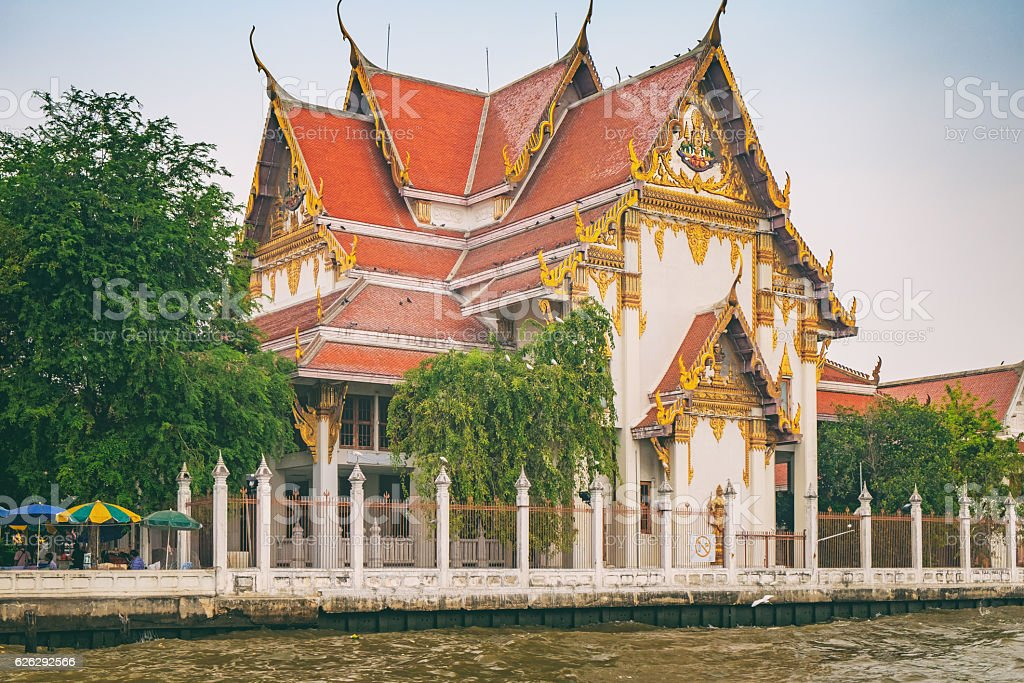 Buddhist Temple is located on the banks of the river stock photo