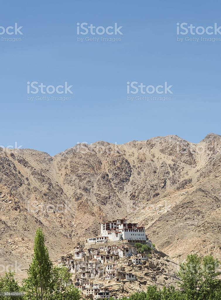 Buddhist temple on hill tree bordered with mountains on background stock photo