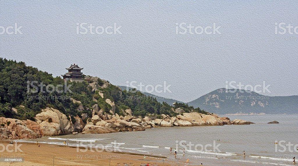 Buddhist temple towering above beach, China stock photo