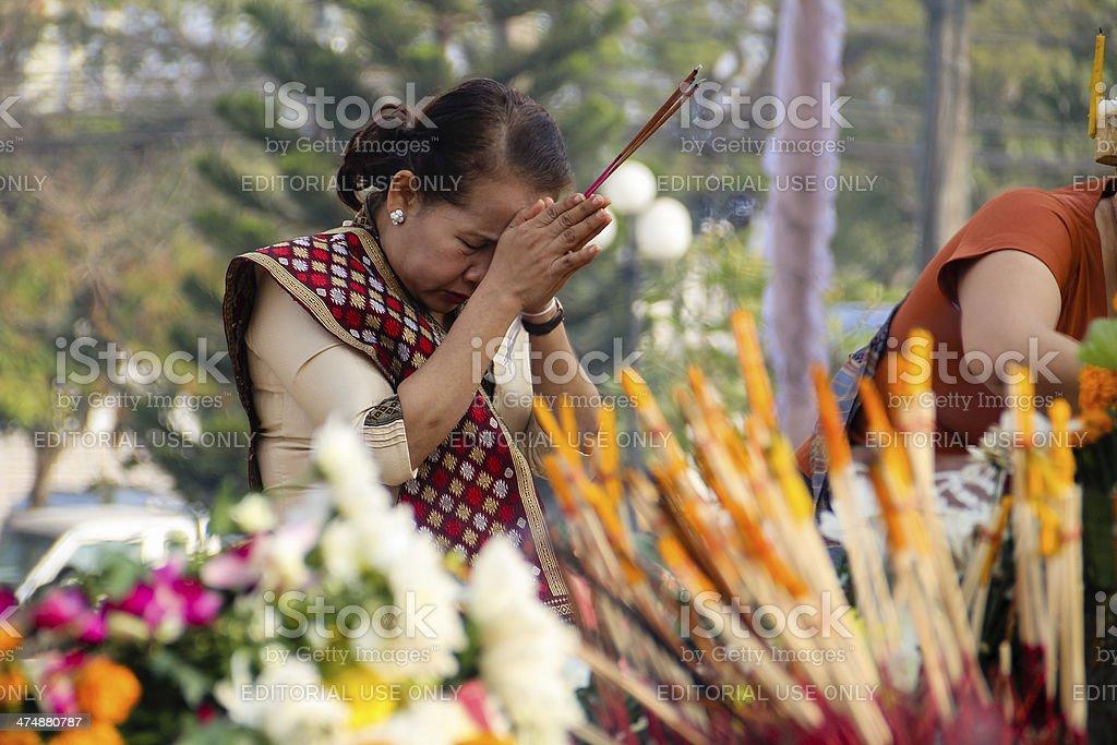 Buddhist Woman Praying in Laos stock photo
