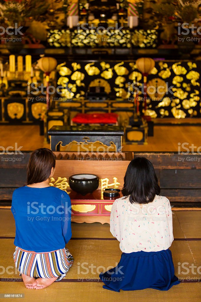 Buddhist Women Praying in a traditional Japanese temple stock photo