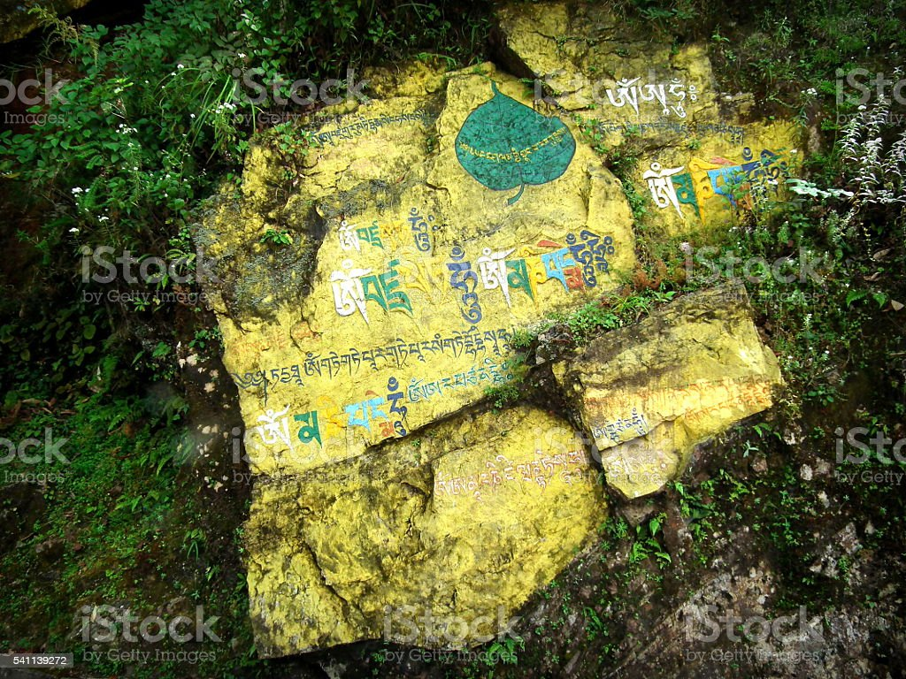 Buddhist writing on stones stock photo