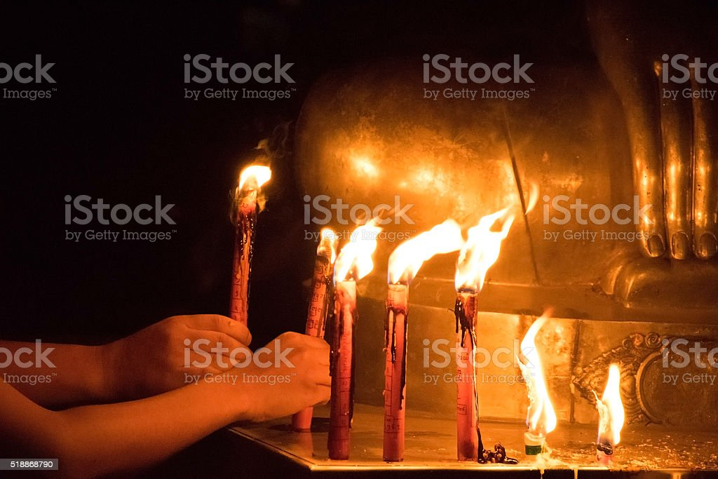 Buddhists worship the Buddha with candle and light stock photo