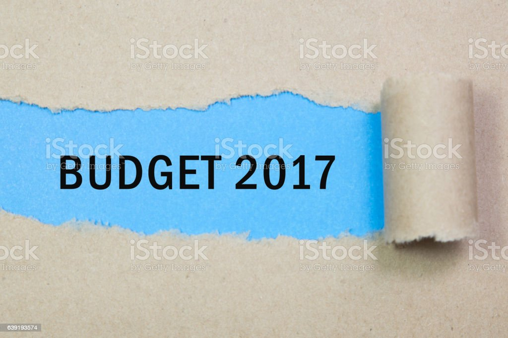 Budget 2017 word written under torn brown paper. stock photo