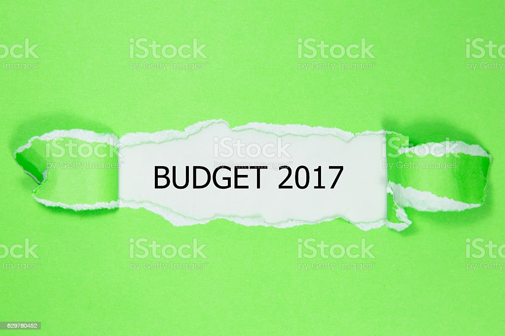 Budget 2017 word written under torn paper. stock photo