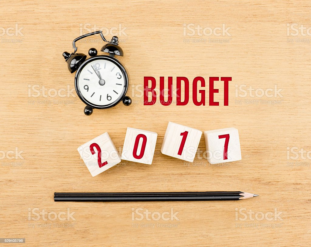 Budget 2017 year on cube with pencil and clock stock photo