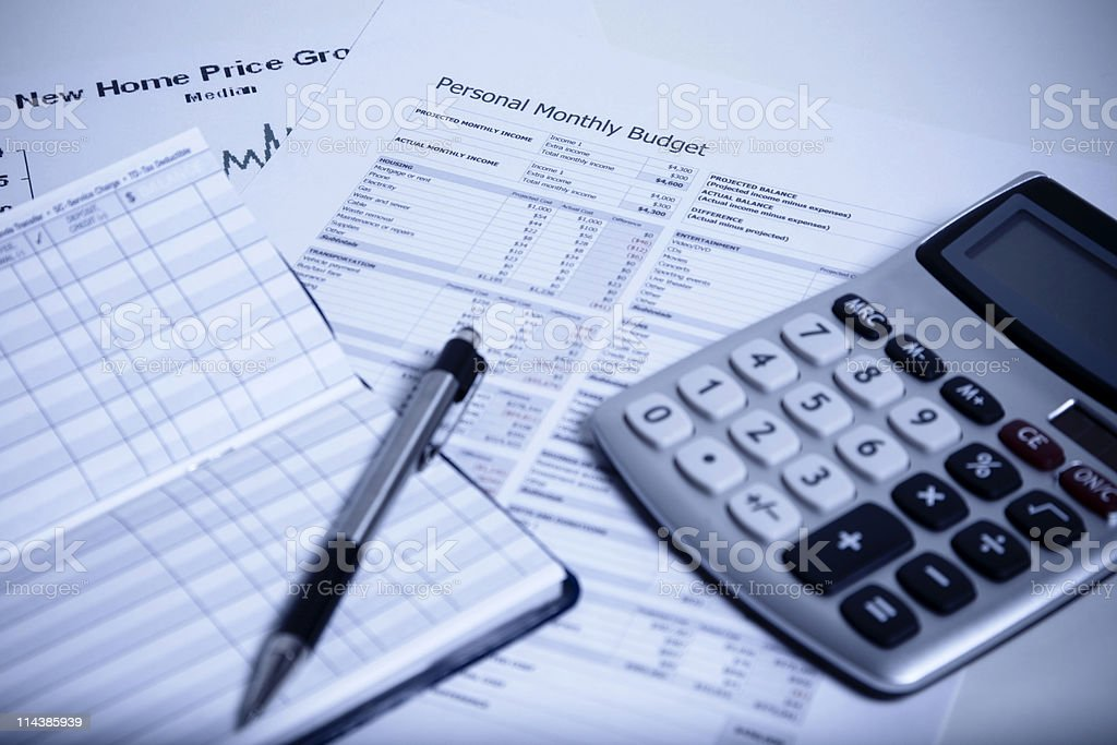 Budgeting paperwork, checkbook, pen, and calculator royalty-free stock photo