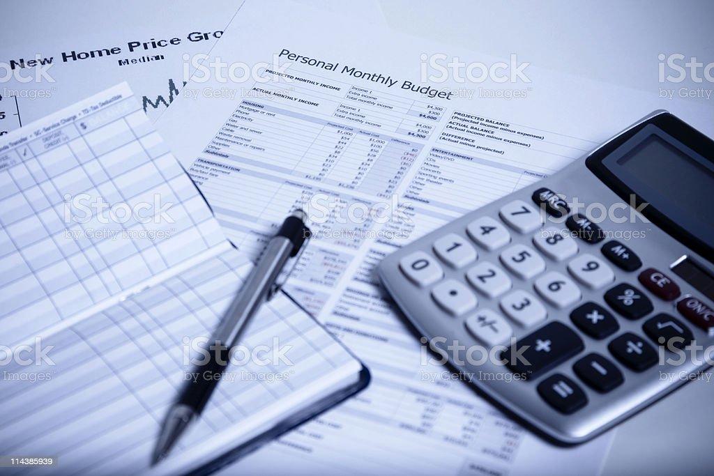 Budgeting paperwork, checkbook, pen, and calculator stock photo